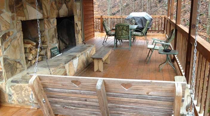 12-38-deck-showing-fireplace-swing-table-and-grill